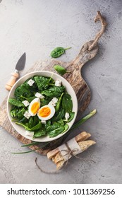 salad with spinach with egg and feta cheese and with sesame seeds and toast