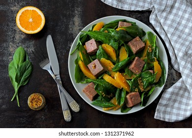 Salad with spinach, orange and smoked salmon. Paleo diet, keto diet, pegan diet. Healthy fitness salad with spinach and fish.