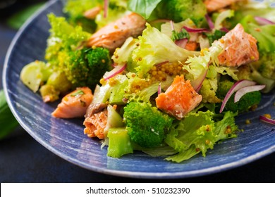 Salad of stewed fish salmon, broccoli, lettuce and dressing. Fish menu. Dietary menu. Seafood - salmon.