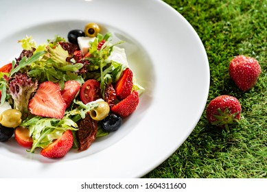 salad with strawberries and olives