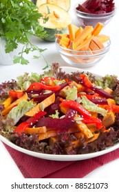 Salad with sweet pepper, pumpkin and beetroot on the white background