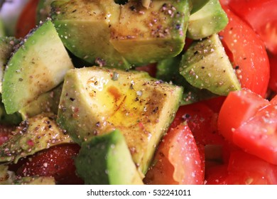 salad with tomato avocado lettuce pepper and olive oil