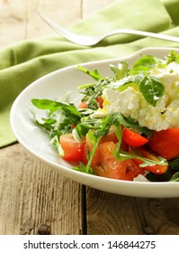 salad with tomato basil and soft goat cheese