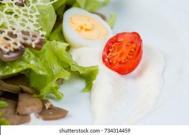 Salad, tomato cherry and boiled egg