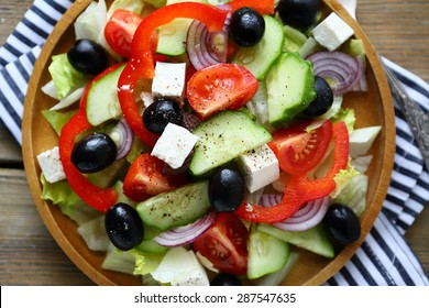 salad with tomatoes and olives, top view