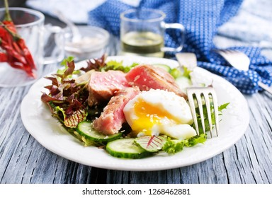 salad with tuna and boiled egg on plate