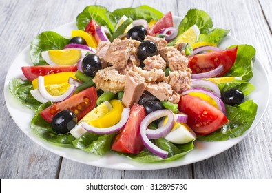 salad with tuna, classic recipe, french cuisine, close-up