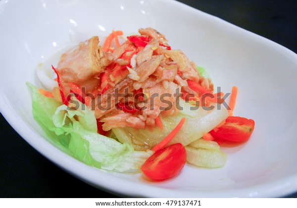 salad with tuna in a white bowl