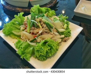 salad with vegetable and mushroom on white dish, food herb