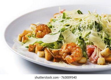 Salad vegetable and shrimps on a light background