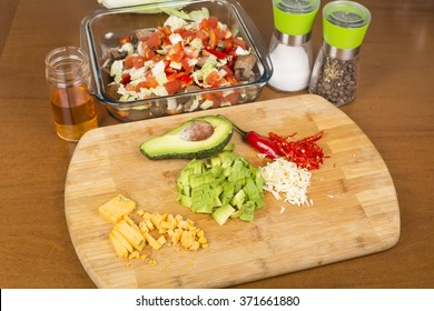 salad vegetables and ingredients sliced on a cutting board
