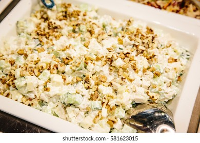 Salad with vegetables, meat and dressing: sour cream, mayonnaise close up
