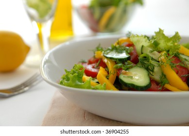 Salad from vegetables (tomatoes, cucumbers, pepper, salad, an onions, fennel).