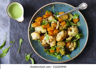 Salad of warm roasted vegetables, cauliflower, brussel sprouts, butternut squash and beans with green dressing