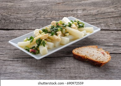 Salad with white asparagus and rhubarb sauce with herbs