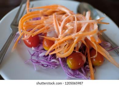salad in white plate, carot tomato purple cabbage salad