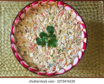 Salade Olivier is a salad composed of diced potato, vegetables and sometimes meats bound in mayonnaise.