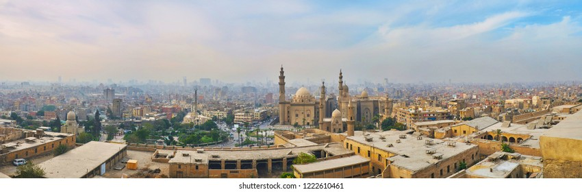 Saladin Citadel is best place to observe the old town, covered with evening fog, with rising minarets of Al Rifai', Sultan Hassan and Al-Mahmoudia mosques, Cairo, Egypt.