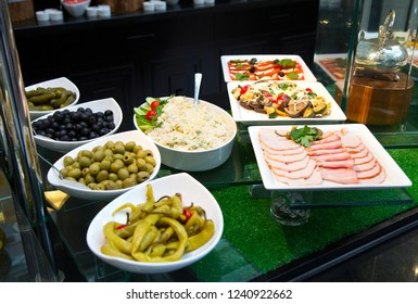 Salads and appetizers, Banquet table with delicious festive food. Variety of food and snacks