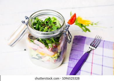 Salads with arugula  radish  tomatoes  seeds and cucumber in glass jars. Healthy food  diet and detox concept