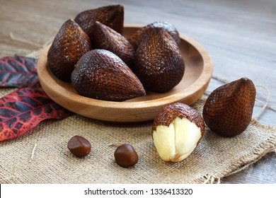 Salak fruit known as snake fruit native from Java island on wooden plate served on the table