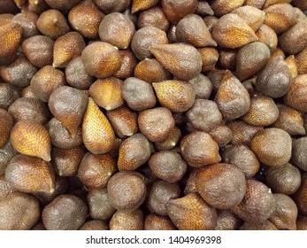 Salak fruit (Salacca zalacca) sell in the market. Salak fruit in market. Salak fruit  background.