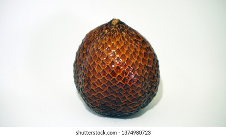 Salak is one of tropical fruit that can be found in Indonesia. This image shows Salak using white background
