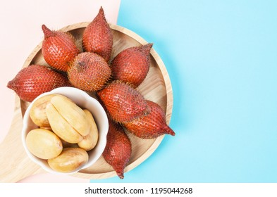 Salak Palm , waive or snake fruit in wooden dish on table with empty space for your text or message.