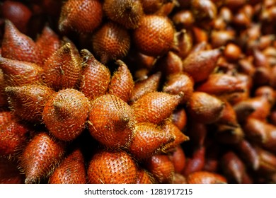 Salak or salacca or snake fruit is native to Indonesia. The flesh is yellow-white and has a crispy apple-like texture, and a juicy, sweet and sour taste. Selective focus.