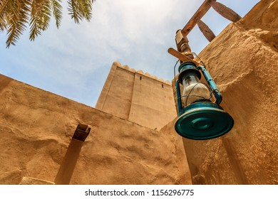 Salalah, Oman - 2018. Medieval oil lamp hanged on a wall. Old castle in Salalah, Sultanate of Oman.