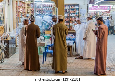 SALALAH, OMAN - FEBRUARY 24, 2017: Local men at a frankincense stall at Al Husn Souq in Salalah, Oman