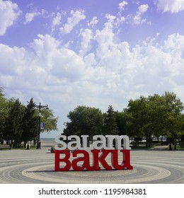 Salam Baku welcome Title at the Milli Park under the Cloudy Blue Sky.
