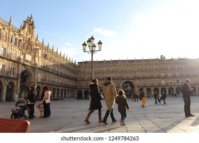 SALAMANCA, CASTILE AND LEON/SPAIN - DECEMBER 01, 2018: People enjoy, walk and talk in the main square of Salamanca, which is a meeting place.