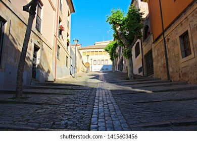 SALAMANCA, CASTILE AND LEON/SPAIN, JUNE, 01, 2019: cobblestone street in slope in the urban and historical center, called Cuesta de Carvajal, where the Salamanca cave is accessed