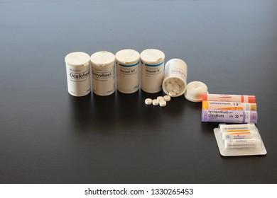 SALAMANCA, CASTILE AND LEON/SPAIN, MARCH, 5, 2019: homeopathy, alternative natural medicine on black background. Heels brand pills.