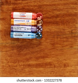 SALAMANCA, CASTILE AND LEON/SPAIN, MARCH, 7, 2019: tubes of homeopathy globules on wood background