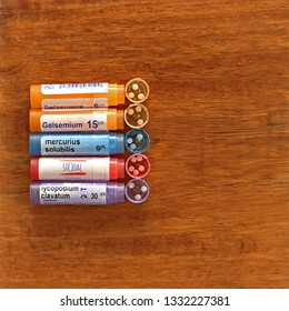 SALAMANCA, CASTILE AND LEON/SPAIN, MARCH, 7, 2019: Homeopathic medicines on brown background.