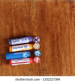 SALAMANCA, CASTILE AND LEON/SPAIN, MARCH, 7, 2019: assortment of homeopathy medicines on wood background. Top view.