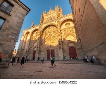 Salamanca ´s Catedral Nueva , Salamanca, Spain, August 2019:  Tourists admiring the beauty of the main façade, together with the Old Cathedral, this is one of the two cathedrals of Salamanca,