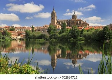Salamanca Old and New Cathedrales reflected on Tormes River