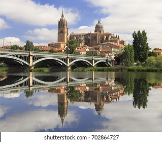 Salamanca Old and New Cathedrales reflected on Tormes River, Spain