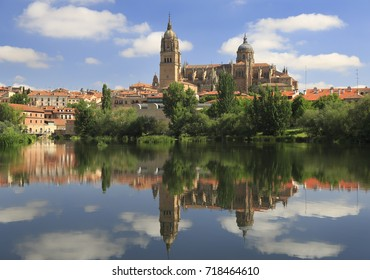 Salamanca Old and New Cathedrals reflected on Tormes River