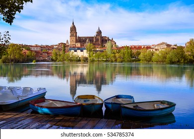 Salamanca skyline with Tormes river boats in Spain