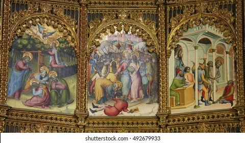 SALAMANCA, SPAIN - AUGUST 2, 2016: Paintings of the Judas kiss, the Garden of Gethsemane and Good Friday on the retable (1430-1450) of the Old Cathedral of Salamanca, Spain.