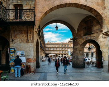 Salamanca, Spain - June 12, 2018: Archway entrance to the famous and historic Plaza Mayor in Salamanca, Castilla y Leon, Spain - UNESCO World Heritage Site