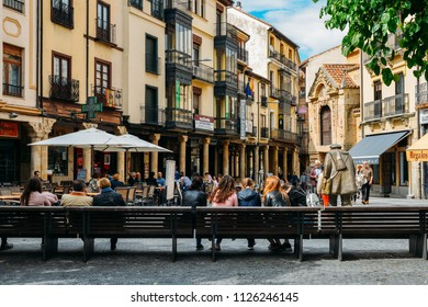 Salamanca, Spain - June 12, 2018: Tourists relax at a bench in the historic centre of Salamanca, Castilla y Leon, Spain - Unesco World Heritage Site