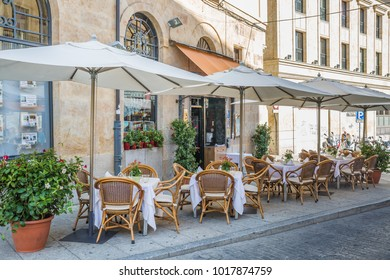 SALAMANCA, SPAIN - OCTOBER, 2016: cityscape. street city cafe with many empty tables in downtown of Salamanca Spain