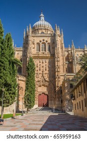 SALAMANCA, SPAIN - OCTOBER, 2016: cityscape. tourists take a rest in square in the front of cathedral Nueva facade in Salamanca Spain.