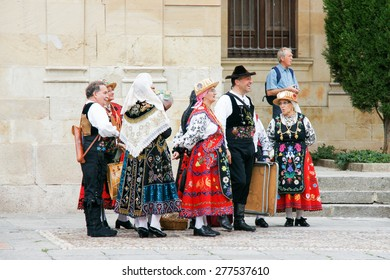 SALAMANCA, SPAIN - SEPTEMBER 8: Unidentified people with traditional costumes in Cathedral Square on September 8, 2012 in Salamanca, Spain. It was declared a UNESCO World Heritage Site in 1988.