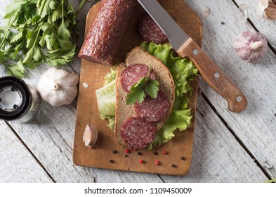 salami and bread on a wooden board